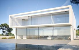Off-plan residential for sale overseas. Modern two-storey villa with a pool and a garden, on the first line from the sea, El Mas Pinell, Spain