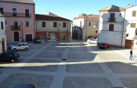 2 bedroom houses by the sea for sale in Italy. Home to renovate in the center town with view on the main square