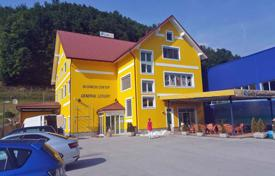 Property for sale in Slovenia. Located in Rogatec, third floor and attic of this multi purpose building is for sale