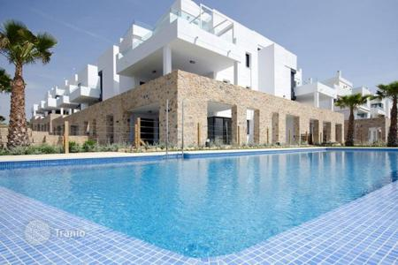Apartments with pools for sale in Valencia. Apartment with spacious terrace, in a new residence with garden and swimming pool, near the beach, in Dehesa de Campoamor, Alicante, Spain