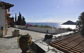 Coastal houses for sale in Porto Rafti. Renovated villa with fireplaces, a private access to the beach and a parking, at 50 meters from the sea, Porto Rafti, Greece