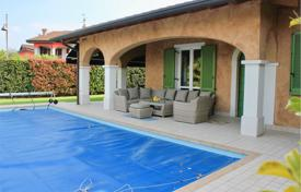 Houses with pools for sale in Lake Garda. Cozy furnished villa with a pool and a garden in the city center, Moniga del Garda, Italy