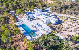 Luxury villas and houses for rent with swimming pools in Ibiza. Designer villa with a pool, seating areas, a garden and sea views, Ibiza, Balearic Islands, Spain