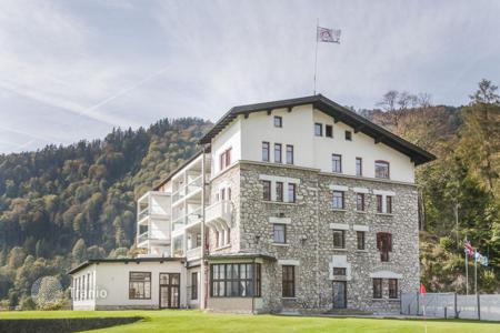 Apartments for sale in Oberaudorf. Magnificent apartment in a historic building with stunning views of the Kaiser Mountains and Lake Luegsteinsee and valley of river Inn