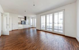 Penthouses for sale in Germany. Elite penthouse with two terraces and a garden in a modern condominium with a playground, Mitte, Berlin, Germany