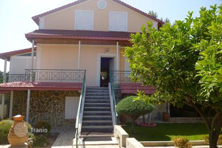 5 bedroom houses for sale in Greece. Villa with an independent apartment, a garden and a garage, at 350 meters from the sea, Corinth, Greece