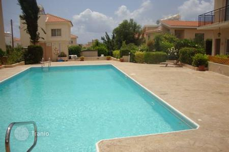 Cheap townhouses for sale in Cyprus. Townhouse in a small residential complex with a swimming pool in Peyia, Paphos