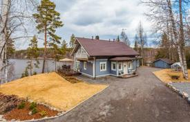 Property for sale in Finland. Log cottage with an elegant interior, on a plot with a sauna and a garage, near a lake and a private beach, Tampere, Finland