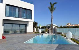 Property for sale in Dehesa de Campoamor. Modern detached villa with private pool and sea views in Campoamor