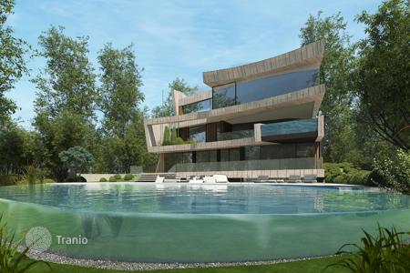 Off-plan residential for sale in Spain. New villa in Barcelona, Spain. House with a garden and a water lily pond, spacious terraces and a jacuzzi, in prestigious Pedralbes district