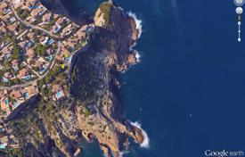 Off-plan residential for sale in Spain. Large plot of land with a house on the beach in Javea, Alicante