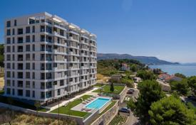 Apartments with pools by the sea for sale in Split. Bright flat with a loggia and sea views in a comfortable residence, near the beach, Split, Splitsko-Dalmatia County, Croatia