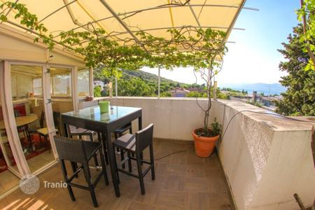 Apartments for sale in Split-Dalmatia County. Apartment with winter garden, fireplace and sauna in Split