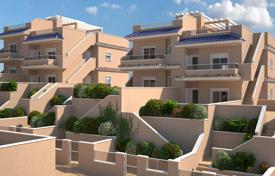3 bedroom apartments by the sea for sale in Spain. Three bedroom ground floor bungalow with a garden and a parking in a complex with pools, a gym and a playground, Punta Prima, Spain