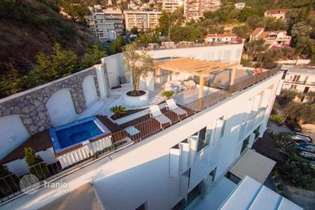 Residential for sale in Budva. The apartment is in a complex of luxury class with a terrace overlooking the sea in the village of Miločer