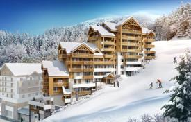 4 bedroom apartments for sale in Auvergne-Rhône-Alpes. Spacious penthouse with a balcony and mountain views, in a new residence next to the ski slope and the cable car, Yue, Isère, France