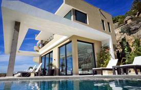 Luxury villas and houses for rent with swimming pools in Ibiza. Beautiful villa on a hill overlooking the sea, with a private pool, a garden, outdoor terraces and parking, Ibiza, Spain
