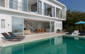 Residential for sale in Southeastern Asia. Snow white villa with pool and panoramic view of the city and ocean on the island of Koh Samui, Thailand