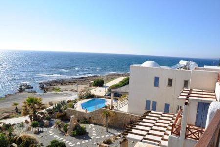 Coastal residential for sale in Chloraka. Villa with roof terrace, garden, swimming pool and terrace, on the beach, in Chloraka, Cyprus