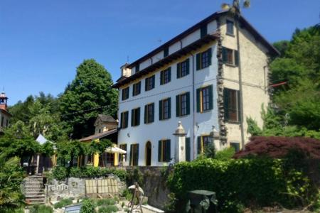 Property for sale in Orta San Giulio. On the hills of Lake Orta, restored farmhouse with beautiful lake view