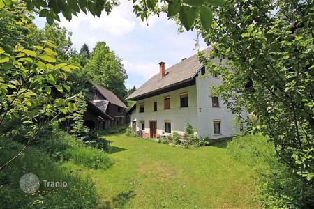 Houses for sale in Radovljica. This is a house with garden bordering the lovely Radovna river