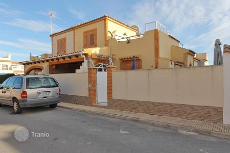 "Cheap apartments with pools for sale in Spain. Orihuela Costa, Playa Flamenca Urb. ""Serena III. Semi detached house of 70 m² built with plot of 60 m²"