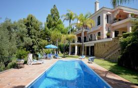 Luxury 4 bedroom houses for sale in Marbella. Elegant villa with a private garden, a pool, a terrace and a sea view, Marbella, Spain