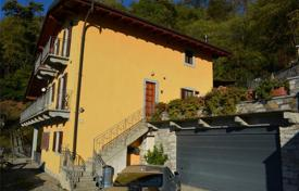 Houses with pools for sale in Verbania. Cozy villa with an attic, a terrace, two balconies and lake views, near the city center, Verbania, Piedmont, Italy