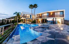 Luxury houses with pools for sale in Costa Blanca. Elite three-level villa with stunning views of the sea and the beach in Benidorm, Alicante, Spain