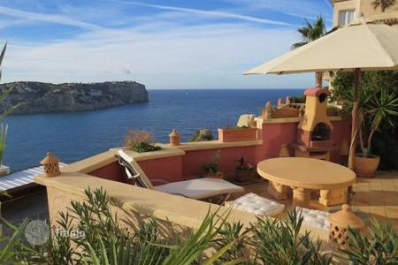 Apartments with pools for sale in Andratx. Cozy apartment with beautiful sea view in Cala Moragues, Port Andratx, Mallorca, Balearic Islands, Spain