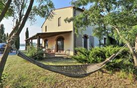 Property for sale in Santa Luce. Charming villa overlooking the lake in Santa Luce, Tuscany, Italy