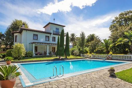 Houses with pools for sale in Bilbao. Three-storey villa with a spacious swimming pool, a terrace and a large landscaped garden, Cantabria, Bilbao, Spain