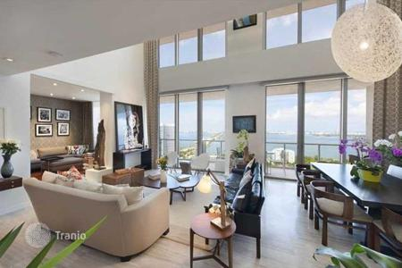 4 bedroom apartments for sale in North America. Renovated two-level penthouse with south, north and east facing windows and a view of the downtown and Miami Beach, Miami, Florida