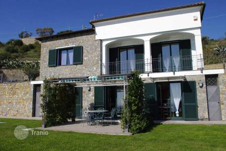 4 bedroom houses for sale in Sanremo. Modern villa in San Remo, Italy. Picturesque garden, swimming pool, garage, view of the sea and the city
