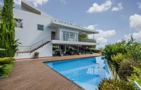 Luxury residential for sale in Costa del Garraf. Modern three-storey villa with terraces, a pool and a garden, overlooking the sea, in a prestigious residential area, Sitges, Spain
