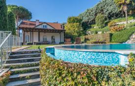 Luxury 4 bedroom houses for sale in Lake Como. Three-storey villa with an infinity pool, a beautiful garden and an elevator, near the lake, Cernobbio, Lombardy, Italy