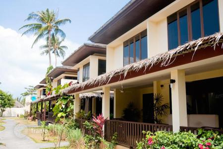 Townhouses for sale in Southeast Asia. Townhouse in a residential complex surrounded by tropical vegetation and direct access to the beach in the area of Plai Laem