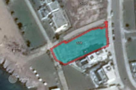 Property for sale in Tomb of the Kings. 902 m² plot in Paphos 35 meters from the sea