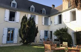 Property for sale in Aquitaine. A historic villa with a veranda and a spacious garden, in a quiet village, in the triangle of Pau, Tarbes and Lourdes, France