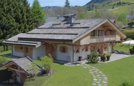 Luxury houses for sale in Haute-Savoie. Three-storey chalet with a large terrace, a garage and mountain views, Megeve, Alpes, France
