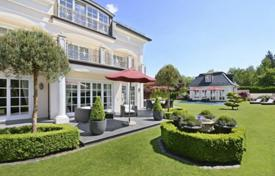 Houses for sale in Germany. Beautiful villa with a garden, a pool, a guest house, a wine cellar and a garage in the prestigious district of Grünwald, Munich, Germany