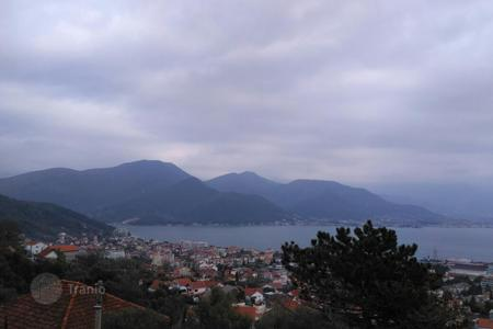 Property for sale in Bijela. Three-level house overlooking the sea and mountains in the city of Bijela, Montenegro