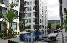 Coastal buy-to-let apartments in Thailand. Furnished two-bedroom apartment in a modern complex with swimming pools, a restaurant and garden close to Kamala Beach, Phuket