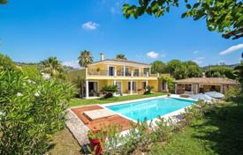 4 bedroom houses for sale in Côte d'Azur (French Riviera). Beautiful villa with a garden, a swimming pool, a parking and views of the village and the mountains, Mougins, France