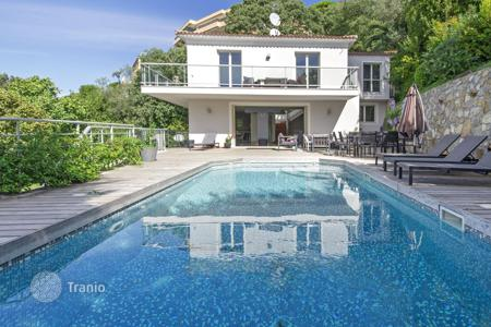 Houses for sale in Nice. Contemporary style villa with garden, swimming pool and panoramic views near the port of Nice, Cote d`Azur, France