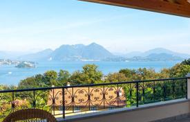 Apartments for sale in Italy. Apartment with a private garden, a garage and a terrace overlooking Lake Maggiore, in a new residential complex in Baveno, Italy