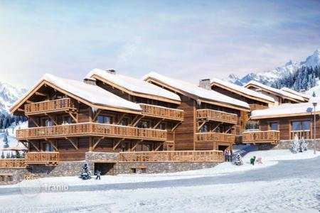 Cheap new homes for sale in Auvergne-Rhône-Alpes. Spacious apartment with large terrace in a popular ski resort in Meribel, French Alps, France