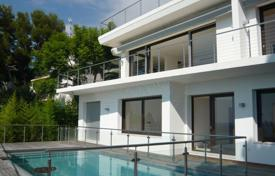 Houses with pools for sale in Èze. Modern villa with a panoramic terrace on the roof and near the beach in Eze-sur-Mer