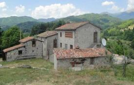 Property for sale in Barga. Three-storey stone villa with a large plot in Barga, Tuscany, Italy