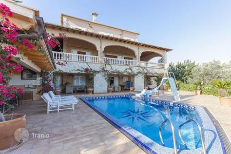 5 bedroom houses for sale in Majorca (Mallorca). Chalet with a fireplace, large terraces, a pool, a garden, views of the mountains and the bay, Bunyola, Spain